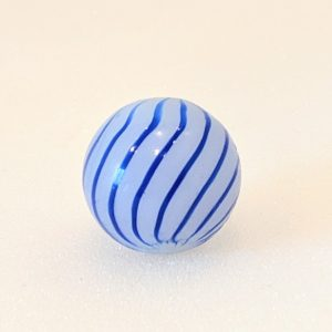 13 cobalt symmetrically spaced lines on a semi-translucent white base clambroth.