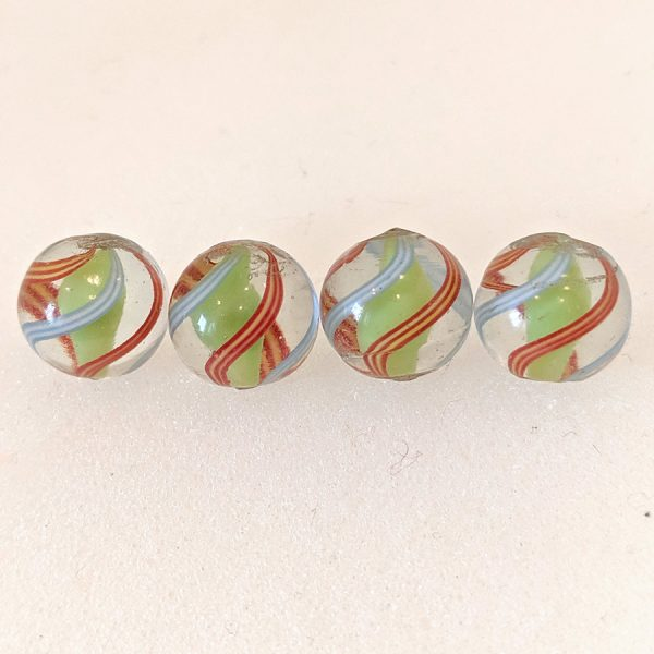 Group of 4 same-cane English lime green solid core swirls with 2 red/yellow striped ribbons and 2 outer light blue/white striped ribbons.