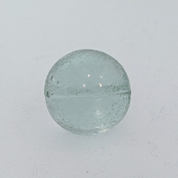 Clear bullet mold marble. Not constructed with a pontil